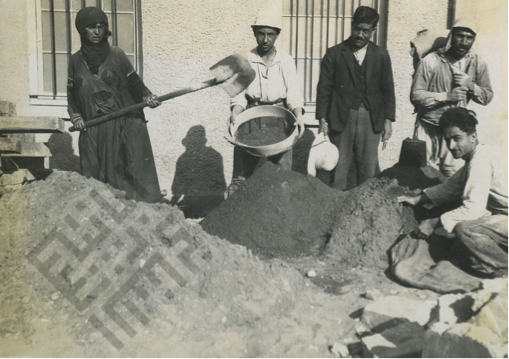 A photo of four men and one woman working on a construction site. Creighton Collection, Khayrallah Center Archives