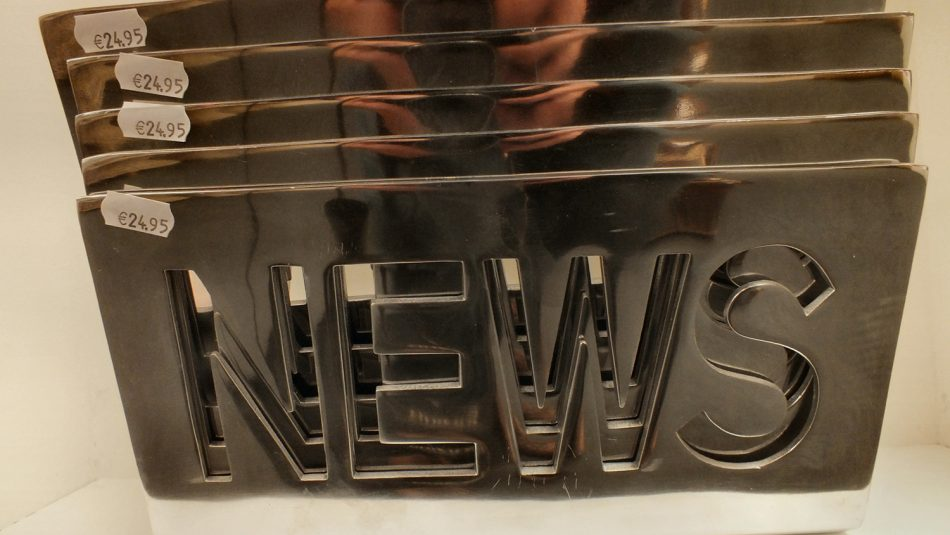 "A license plate reads, ""News."""