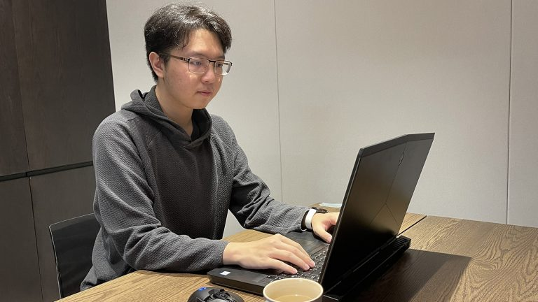 student working on computer