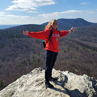 Lindsey Fath standing on mountain