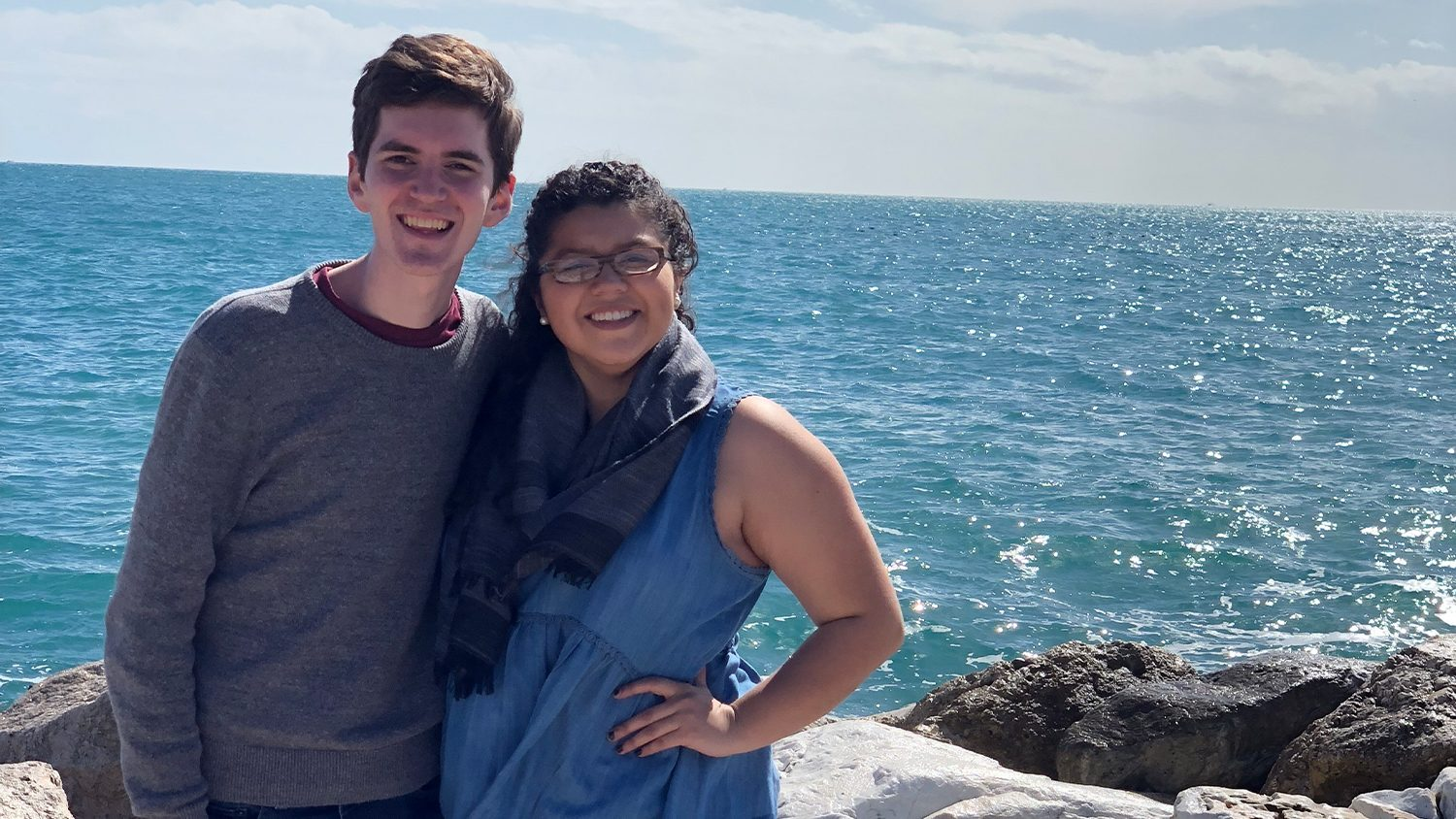 Mitchell Moravec and Jackie Gonzalez standing by ocean