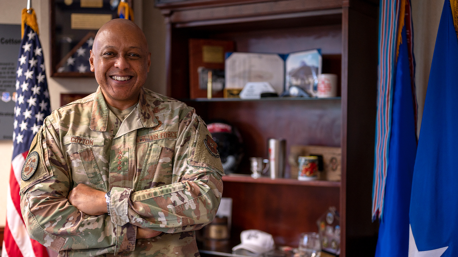 Gen Anthony Cotton in his military uniform and standing with his arms crossed in his office