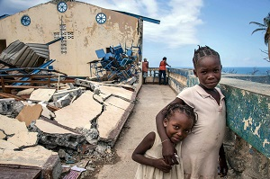 On 13 October 2016 in Jérémie, Haiti, children play at the Église Chrétienne Nan Lindy. Some 300 people have sought temporary shelter at the church.  Countless homes were destroyed by Hurricane Matthew.  More than one week after Hurricane Matthew, as schools re-open across the country, more than 100,000 children will be missing out on learning after their schools were either damaged or converted into shelters. Hurricane Matthew passed over Haiti on Tuesday October 4, 2016, with heavy rains and winds. While the capital Port au Prince was mostly spared from the full strength of the class 4 hurricane, the western area of Grand Anse, however was in the direct path. The cities of Les Cayes and Jeremie received the full force sustaining wind and water damage across wide areas. Coastal towns were severely damaged as were many homes in remote mountainous regions. International relief efforts are underway to provide food water and shelter to the people affected by the storm. An estimated 500,000 children live in the Grande Anse Department and Grand South Department in southern Haiti, the areas worst hit by Hurricane Matthew.  UNICEF had prepositioned emergency supplies with national authorities to reach up to 10,000 people.  On 8 October, six water trucks arrived in Jeremie and Les Cayes, the respective capital cities within the Departments.  Additional water and sanitation supplies, such as water purification tablets, water bladders and plastic sheeting, have been dispatched to the most affected departments in the westernmost tip of Haiti.  As of 10 October, UNICEF delivered blankets, buckets, water purifying equipment and cholera diagnostic kits.  UNICEF is working to reinforce good hygiene practices, especially in temporary shelters, in order to minimize the outbreak of disease.  An investigation is underway to confirm the areas affected by cholera, and to determine the cross-over with hurricane-affected areas.