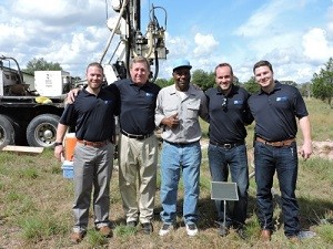 Tommy Cook Jr, Tommy Cook, Charles Foley, Brent Cook, Matthew Cook at drilling site for Skip Cook Memorial Fund in Sublime, TX (PRNewsFoto/Water Well Trust)