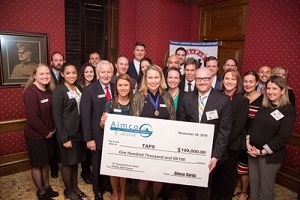 Jarrett Pohle presents a check for $100,000 on behalf of AIMCO Cares to TAPS during a luncheon at the Army Navy Club in Washington, D.C. Wednesday, November 30, 2016.