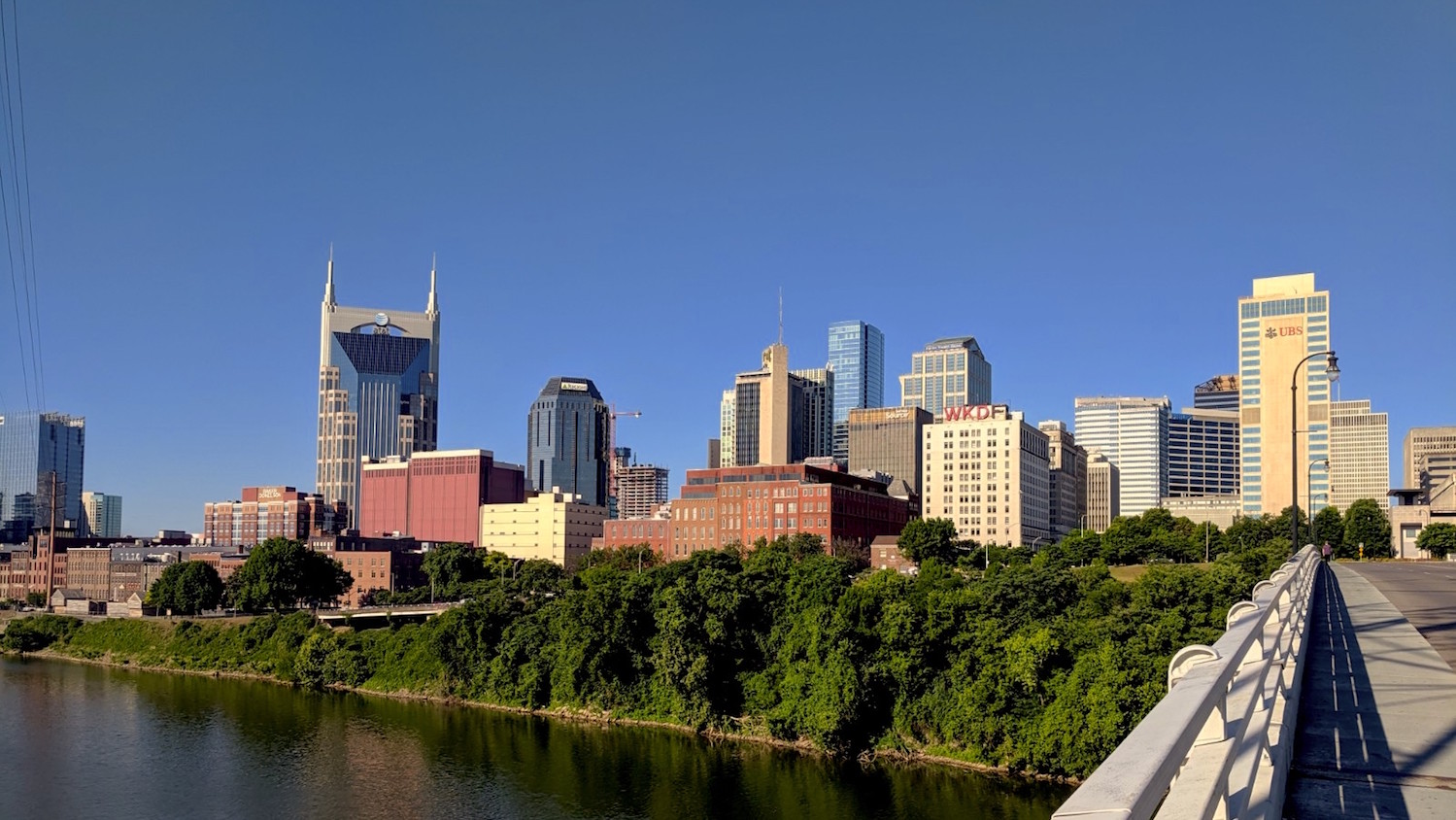 View of Nashville skyline over the river in the sun
