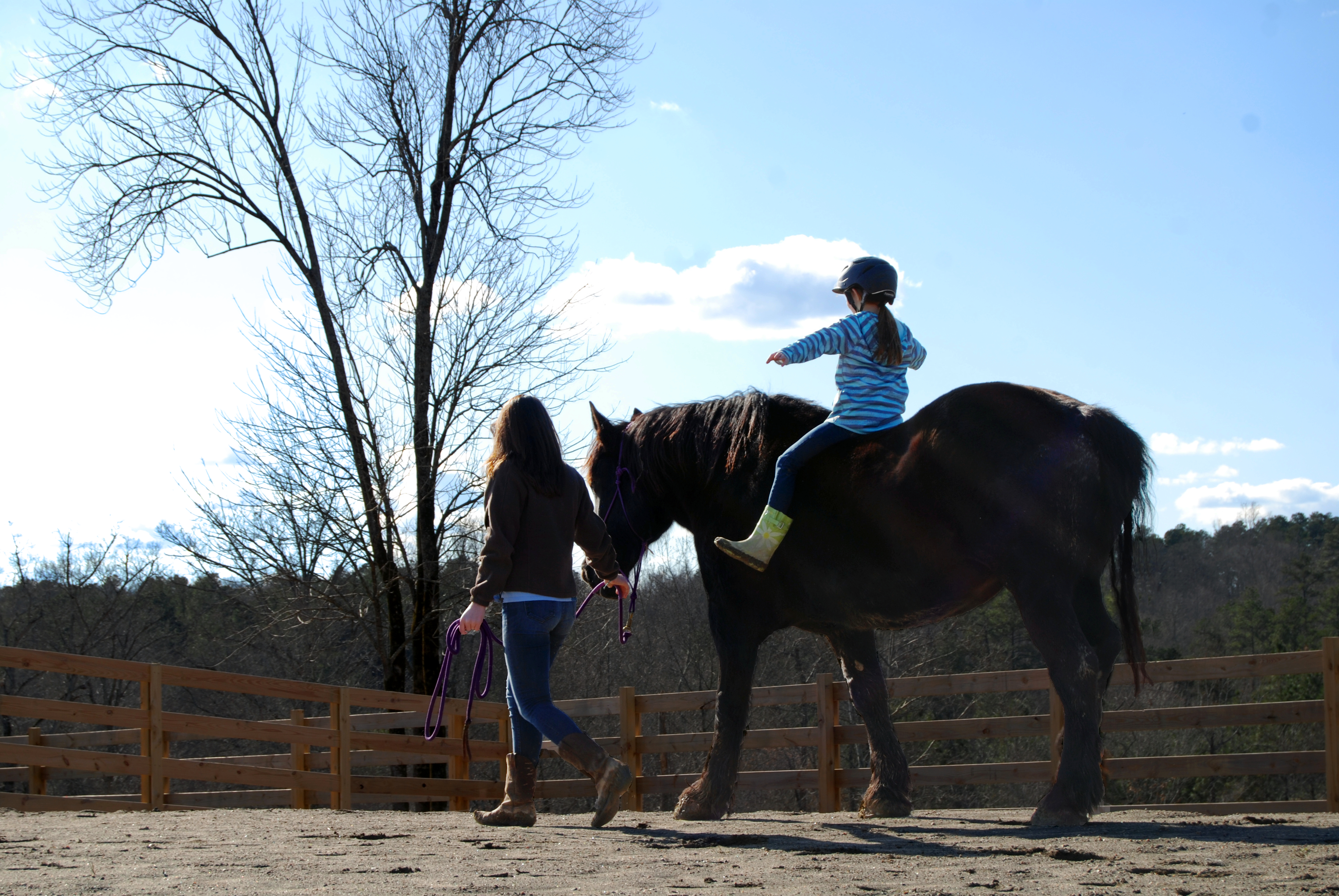 O'Conner leads horse Abby with a child aboard. She says it is humbling and powerful to hear the kids' stories.