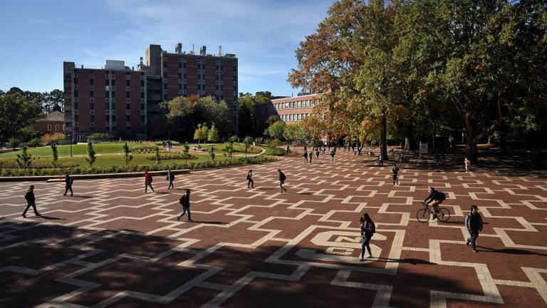 Students walk to class on North Campus at the Brickyard.