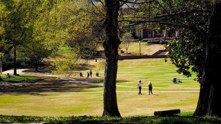 students walking across open field