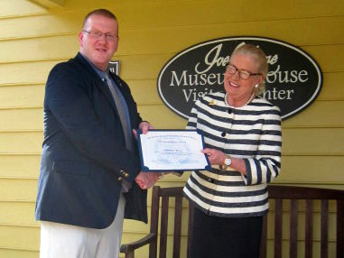 Barbara Lawther presents award certificate to first year doctoral student, Jimmy Wils