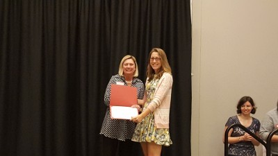 Mandy Benter (Public History alumna, M.A.) receives Excellence Award from Dean Grasso