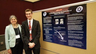 Ross Anderson (History, M.A.), pictured alongside his advisor Dr. Julie Mell, presents his research at the symposium.