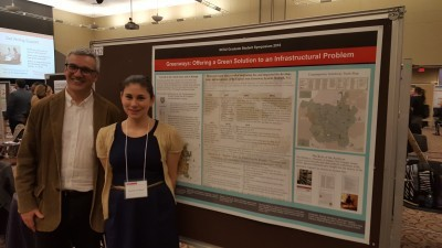 Rachel Jacobson (Public History, M.A.), pictured alongside her advisor Dr. Matthew Booker, presents her poster at the symposium.