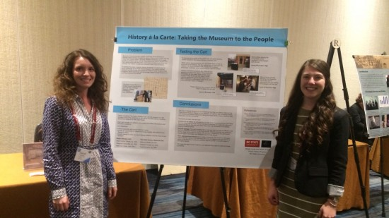 """Sarah Soleim and Abigail Jones present their poster, """"History a la Carte: Taking the Museum to the People"""""""