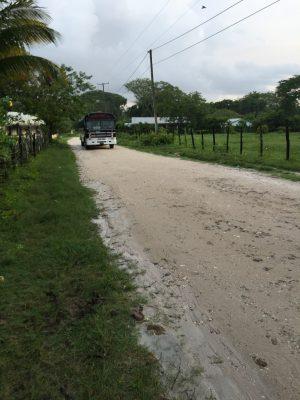 village-bus-coming-down-dirt-road