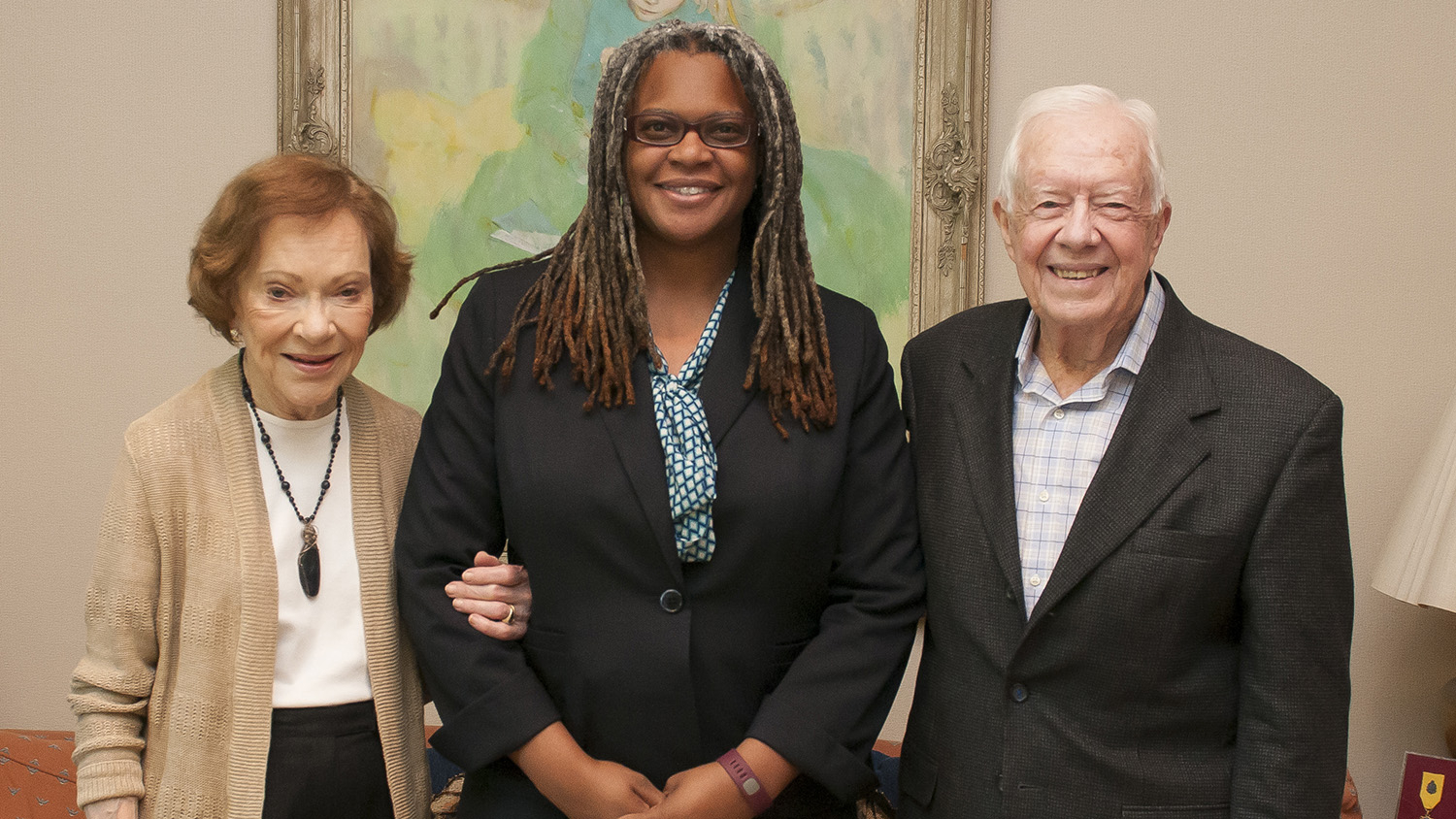 Meredith Evans standing with Jimmy Carter and wife, Rosalynn